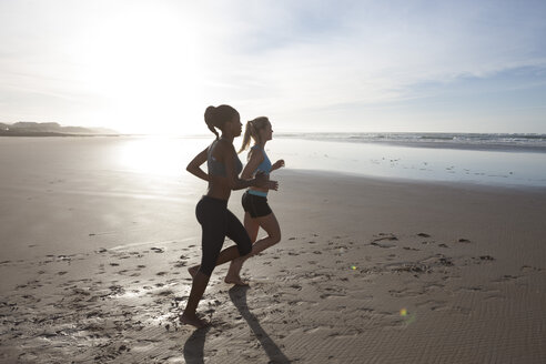South Africa, Cape Town, two women jogging on the beach - ZEF005214