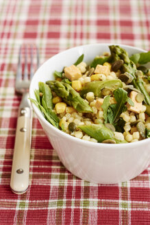 Stetson Salad with pearl couscous, corn, asparagus, arugula, hazelnuts, shallots, vegan cheese, basil pesto and pumpkin seeds - HAWF000784