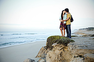 South Africa, kissing couple standing at the coast - TOYF000954