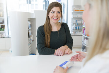 Female pharmacist advising female customer - FKF001112
