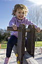 Spain, Gijon, little girl sitting on a rocker - MGOF000250
