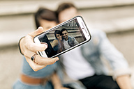 Spain, Gijon, young couple in love taking selfie with smartphone - MGOF000253