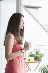 Young woman with coffee cup in the morning - RBF002876