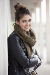 Portrait of smiling young woman with bun - RBF002886
