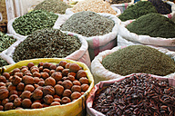 Iran, Isfahan, bags of different spices at grand bazaar - FLF001146
