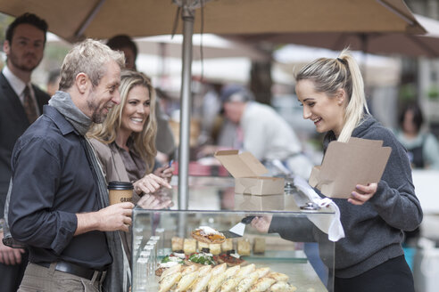 People buying food at city market - ZEF006573