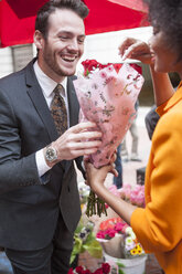 Man buying red roses for a woman - ZEF006585