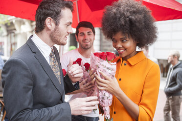 Man buying red roses for a woman - ZEF006588