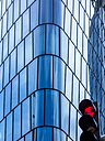 Red light and modern office building in the background, concept building freeze - EJWF000763
