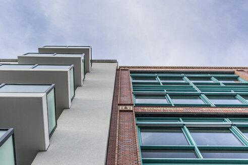 Germany, Berlin, new residential building and refurbished old industrial building side by side - ZM000394