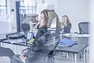 Business people having a meeting in board room - ZEF005667