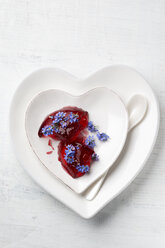 Heart-shaped plates of red jelly garnished with Forget-me-not - MYF001004