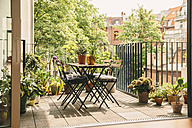 Bistro chairs and table on balcony with view in the yard - MFF001649
