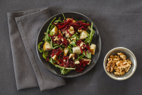 Bowl of beetroot salad with rocket and walnuts - EVGF001836