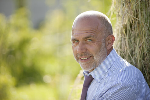 Portrait of smiling businessman in nature - MAEF010637