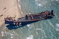 Italy, Lesina, stranded ship wreck at seafront seen from above - KLEF000006
