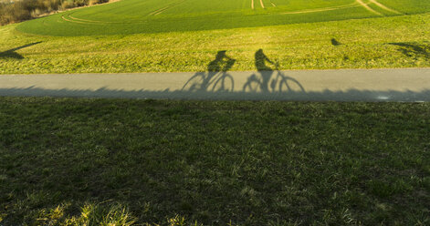 Shadows of couple on bicycles - UUF004567