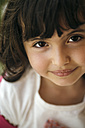Portrait of smiling little girl with brown eyes - MGOF000264
