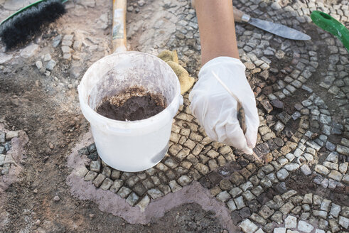 Bulgaria, Plovdiv, archaeologist recovering artifacts of the Roman mosaic in The Great Basilica - DEG000451