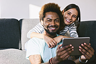Young couple using digital tablet - EBSF000670