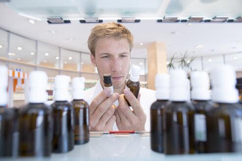 Young pharmacist choosing medicine - SGF001657