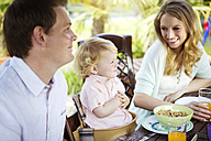 Happy family sitting at breakfast table - GDF000742