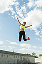 Young woman jumping in the air - UUF004659
