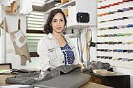 Young seamstress making a jacket - FKF001159