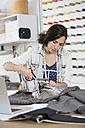 Young seamstress making a jacket - FKF001162