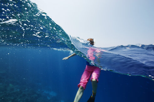 Maldives, woman snorkeling in the Indian Ocean - STKF001287