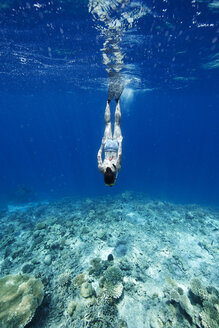 Maldives, woman snorkeling in the Indian Ocean - STKF001293