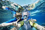 Maldives, portrait of couple snorkeling in the Indian Ocean - STKF001299
