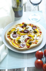 Homemade pizza with mushrooms, yellow peppers, tomatoes, green olives, chorizo and red wine - ODF001135