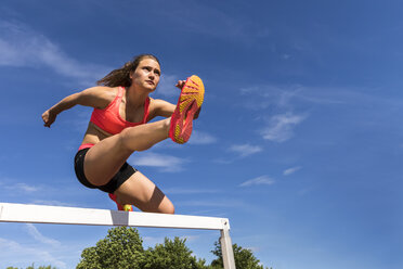 Athlete crossing a hurdle - STSF000807