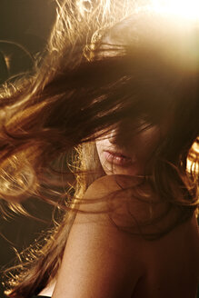 Portrait of a young woman with messy hair and flare - MHCF000012
