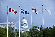 Canada, Montreal, view to Bonsecours Market with flags in the foreground - MHCF000004