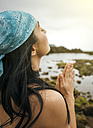 Spain, Gijon, woman doing yoga exercises - MGOF000283