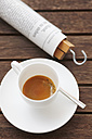 Cup of espresso and rolled newspaper - JTF000674