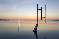 Germany, Baden-Wuerttemberg, Constance, sunrise with sculptures over Lake Constance - KEB000199