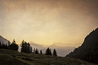 Italy, Lombardy, Chiareggio, Valmalenco, Mountains at sunrise - DWIF000514