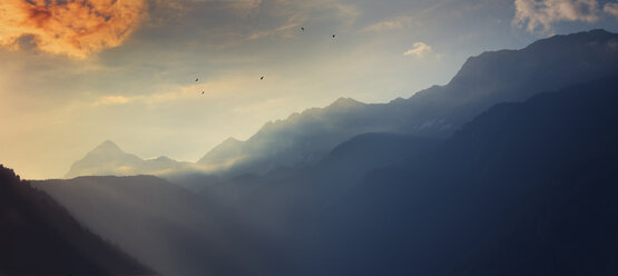 Italy, Lombardy, Chiesa in Valmalenco, Mountains at sunrise - DWIF000524