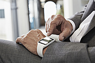 Businessman in office with smartwatch - PDF000977