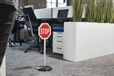 Stop sign in modern open plan office - PDF001060