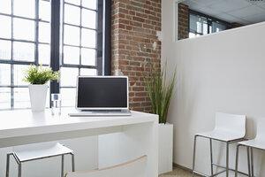 Laptop on desk in modern office - PDF001063
