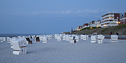 Germany, Lower Saxony, East Frisia, Wangerooge, Beach with beach chairs in the evening, Panorama - WIF002210