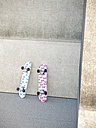 Two skateboards leaning on concrete wall, 3D Rendering - UWF000532