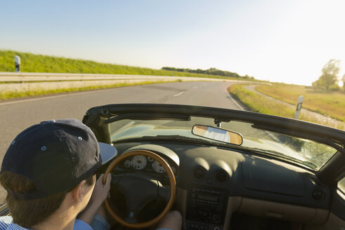 Teenager driving on a country road in a convertible car - MSF004636