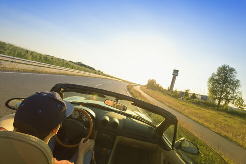Teenager driving on a country road in a convertible car - MSF004635