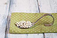 Spoon of dried white beans on cloth - SBDF002036