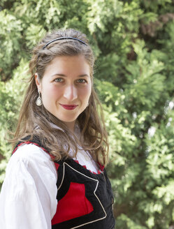 Portrait of smiling woman wearing traditional Hungarian costume - MABF000321